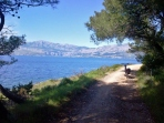 Cycling path between Postira and Lovrečina bay. The view of mainland.